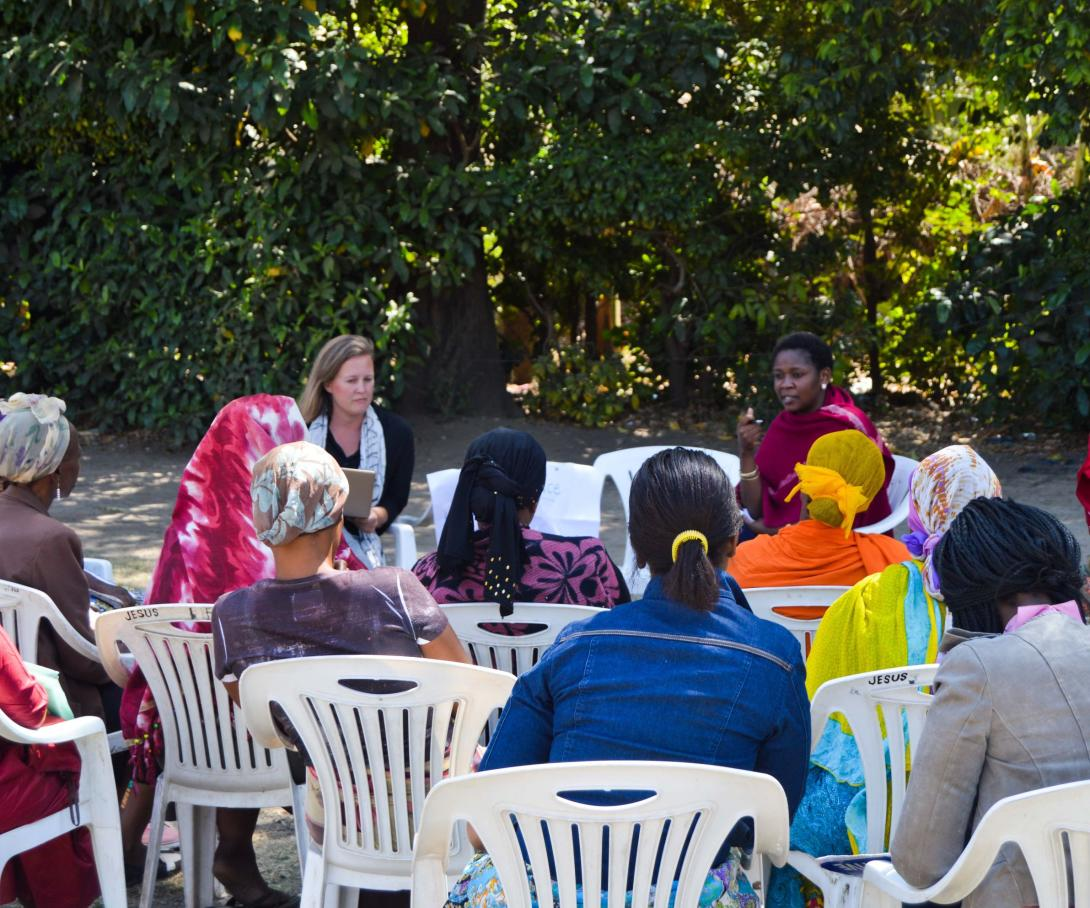 Local women listen to a presentation about human rights on one of our Law internships abroad.